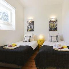 Отель Estrela Premium by Homing Лиссабон комната для гостей фото 3