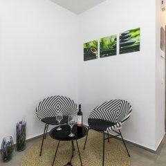 Апартаменты Mirage City Apartments Родос комната для гостей фото 5