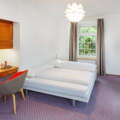 Отель Swiss Night by Fassbind Швейцария, Цюрих - 1 отзыв об отеле, цены и фото номеров - забронировать отель Swiss Night by Fassbind онлайн комната для гостей фото 4