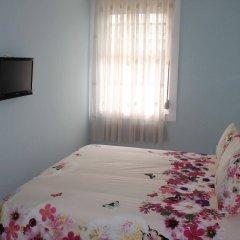 Отель Pensao Grande Oceano Порту комната для гостей