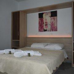 Апартаменты Nikos Apartments комната для гостей фото 5