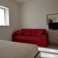 Апартаменты L'Opera Apartments комната для гостей фото 2