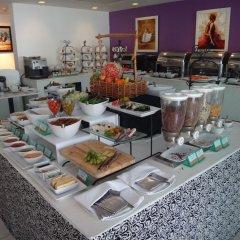 Отель Amari Nova Suites питание фото 2