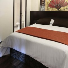 Aztic Hotel & Suites Ejecutivas комната для гостей фото 2