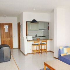 Отель Apartamentos Turisticos Algarve Mor Португалия, Портимао - отзывы, цены и фото номеров - забронировать отель Apartamentos Turisticos Algarve Mor онлайн комната для гостей