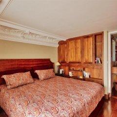 Апартаменты Luxury apartment - garden access Monceau комната для гостей