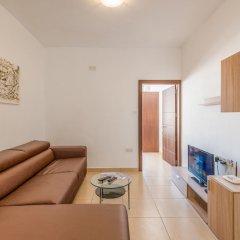 Апартаменты Seashells 2-Bedroom Apartment комната для гостей фото 5