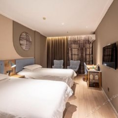 Отель Home Inn (Jiujiang Xunyang Road Pedestrian Street Branch) комната для гостей фото 2