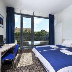 Отель Kaunas City Литва, Каунас - отзывы, цены и фото номеров - забронировать отель Kaunas City онлайн комната для гостей