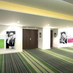 Отель NH Brussels Bloom фитнесс-зал фото 2