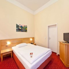 Отель Novum Hotel Gates Berlin Charlottenburg Германия, Берлин - 13 отзывов об отеле, цены и фото номеров - забронировать отель Novum Hotel Gates Berlin Charlottenburg онлайн комната для гостей фото 4