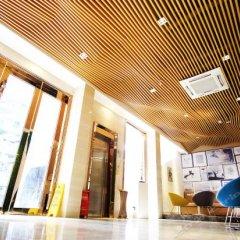 Отель Lucky Orange Hotel Китай, Шэньчжэнь - отзывы, цены и фото номеров - забронировать отель Lucky Orange Hotel онлайн интерьер отеля фото 2