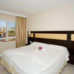 Отель Illot Suite & Spa сейф в номере