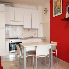 Апартаменты Sunset Apartment Римини в номере