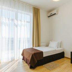 Апарт-отель Имеретинский —Прибрежный квартал Сочи комната для гостей
