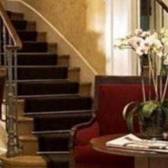 Отель Suites Unic Renoir Saint-Germain Франция, Париж - отзывы, цены и фото номеров - забронировать отель Suites Unic Renoir Saint-Germain онлайн интерьер отеля фото 3