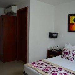 Отель Elite Tequendama Cali Колумбия, Кали - отзывы, цены и фото номеров - забронировать отель Elite Tequendama Cali онлайн сейф в номере