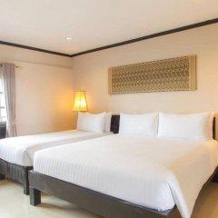 Отель Golden Tulip Essential Pattaya комната для гостей фото 2