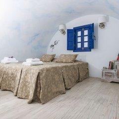 Отель Oia Sunset Villas Греция, Остров Санторини - отзывы, цены и фото номеров - забронировать отель Oia Sunset Villas онлайн комната для гостей фото 4