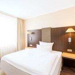 Отель NH Collection Berlin Mitte Am Checkpoint Charlie 4* Стандартный номер с разными типами кроватей фото 18