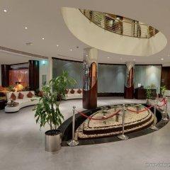 Signature Hotel Apartments & Spa интерьер отеля