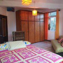 Отель Condo Ora Airport Фааа комната для гостей фото 3