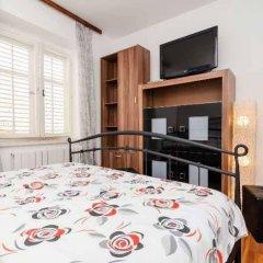 Апартаменты Apartments And Rooms Baltazar комната для гостей