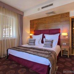 Отель Kempinski Hotel Grand Arena Болгария, Банско - 2 отзыва об отеле, цены и фото номеров - забронировать отель Kempinski Hotel Grand Arena онлайн комната для гостей фото 3