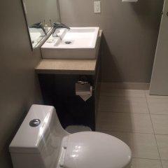 Отель Obasa Suites Saskatoon ванная