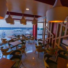 Отель Unima Grand гостиничный бар