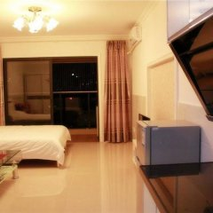 Апартаменты Xingfu Huafu Apartment в номере фото 2