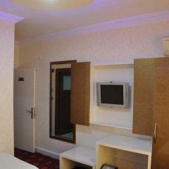 Отель Ugur Otel сейф в номере