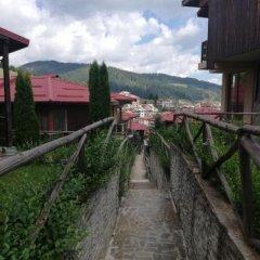 Отель Rodopi Houses Болгария, Чепеларе - отзывы, цены и фото номеров - забронировать отель Rodopi Houses онлайн приотельная территория фото 2