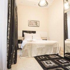 Отель Tbilisi Core: Aquarius Apartment Грузия, Тбилиси - отзывы, цены и фото номеров - забронировать отель Tbilisi Core: Aquarius Apartment онлайн комната для гостей фото 4