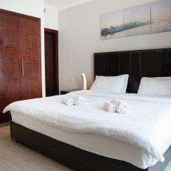 Отель HiGuests Vacation Homes - Burj Views Дубай комната для гостей фото 4