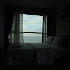 Отель Pattaya Central Sea View Pool Suite Паттайя комната для гостей