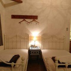 Отель Cottage Morinokokage Япония, Якусима - отзывы, цены и фото номеров - забронировать отель Cottage Morinokokage онлайн комната для гостей фото 5