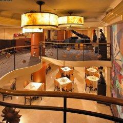 Отель Miramar Hotel Филиппины, Манила - отзывы, цены и фото номеров - забронировать отель Miramar Hotel онлайн интерьер отеля