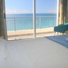 Отель Blue Coral Beach Villas балкон