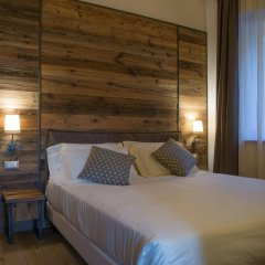 Hotel Garnì Caminetto Горнолыжный курорт Скирама Доломити Адамелло Брента комната для гостей фото 3