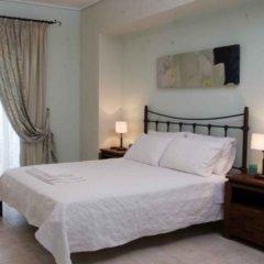 Отель Oasis Beach Hotel Греция, Агистри - отзывы, цены и фото номеров - забронировать отель Oasis Beach Hotel онлайн комната для гостей фото 3