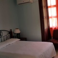 Отель Comfortable Suite 2 комната для гостей