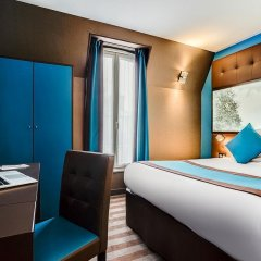 Отель Best Western Nouvel Orleans Montparnasse Париж сейф в номере