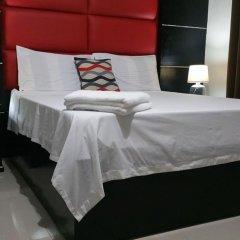 Отель Luxury Suites E Филиппины, Пампанга - отзывы, цены и фото номеров - забронировать отель Luxury Suites E онлайн комната для гостей фото 5