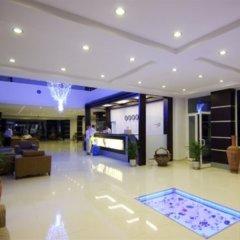 Aquabella Beach Hotel интерьер отеля