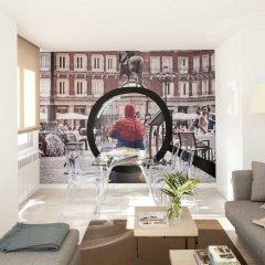Отель Eric Vökel Boutique Apartments - Atocha Suites Испания, Мадрид - отзывы, цены и фото номеров - забронировать отель Eric Vökel Boutique Apartments - Atocha Suites онлайн развлечения