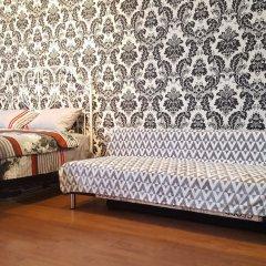 Апартаменты DeLuxe Apartment Vavilova Москва комната для гостей фото 2