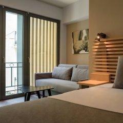 Отель Fos DownTown Suites Афины комната для гостей фото 12