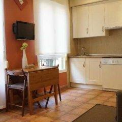 Отель Apartamentos Tirso De Molina в номере фото 2