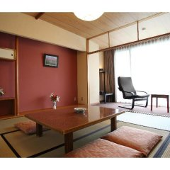 Отель Kadoman Япония, Минамиогуни - отзывы, цены и фото номеров - забронировать отель Kadoman онлайн комната для гостей фото 5